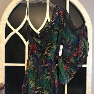 Asymmetrical one sleeved dress. Abstract print